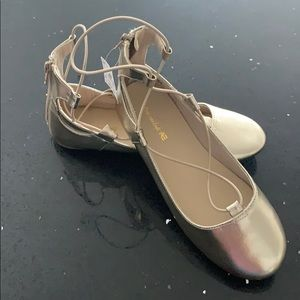 Gold American Eagle ballet shoes in size 4